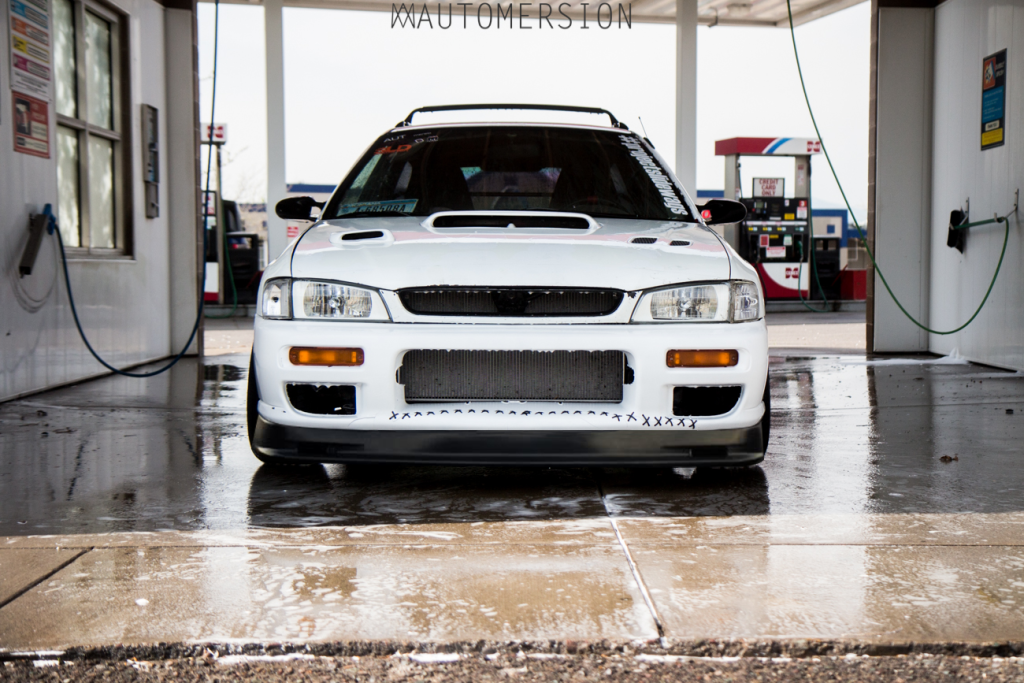 rwd turbo subaru impreza with a honda accord front lip in the car wash